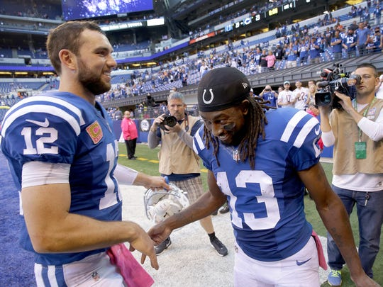 Indianapolis Colts quarterback Andrew Luck (12) and T.Y. Hilton (13) share a moment following their game. The Indianapolis Colts host the Chicago Bears in their NFL football game Sunday, October 9, 2016, afternoon at Lucas Oil Stadium.