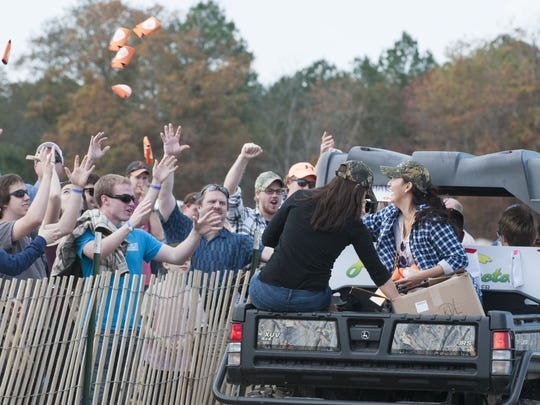 Beer koozies are tossed at crowd members during the World Championship Punkin Chunkin in Bridgeville in 2013.