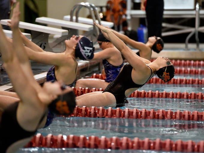 York Suburban's Maddy Abel enters the water for the