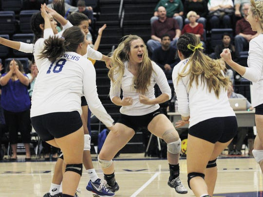 Exeter's Olivia Harden, center, celebrates a point