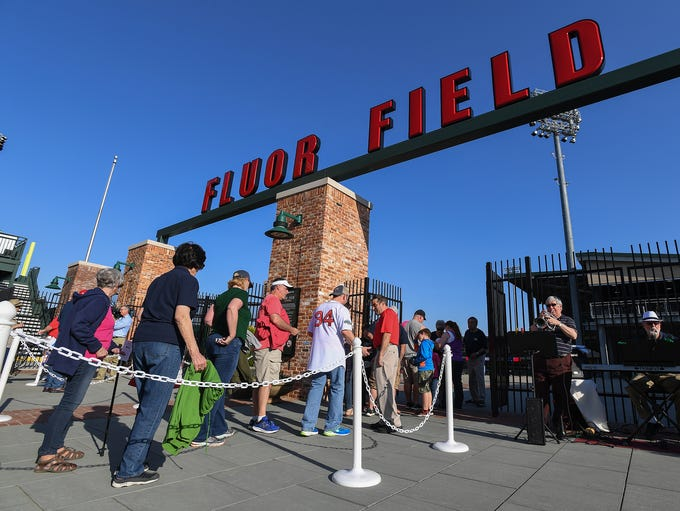 Fans line up at the gates of Fluor Field at The West