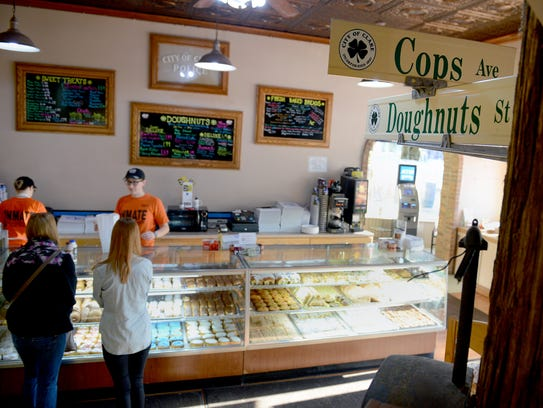 Customers place orders inside Cops & Doughnuts in Clare.