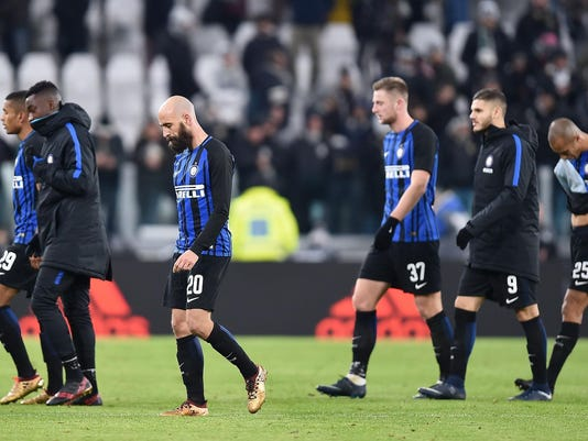 Inter Milan players leave the pitch at the end of the Serie A soccer match between Juventus and Inter Milan at the Allianz Stadium in Turin, Italy, Sunday, Dec. 9, 2017.  The match ended in a scoreless draw. (Alessandro Di Marco/ANSA via AP)