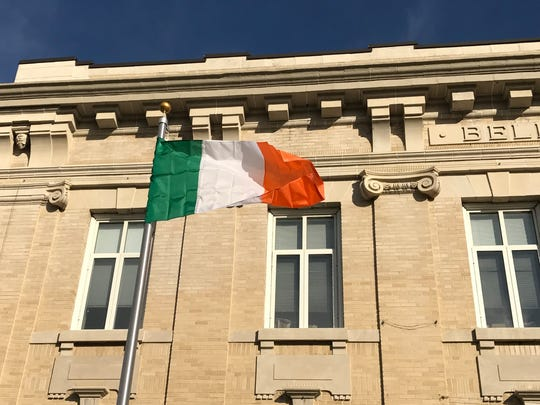 The Irish national flag flies in front of Town Hall