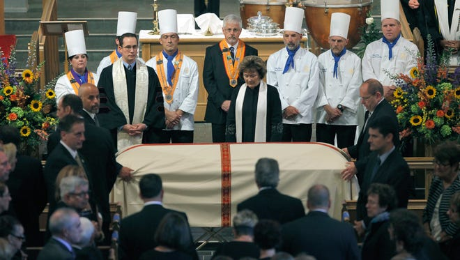 Chefs greet the coffin of longtime convention center leader Joseph Floreano  during his funeral Friday at Asbury First United Methodist Church.