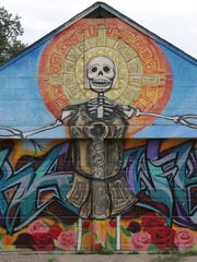Paul Mungar and Freddie Diaz painted this mural near