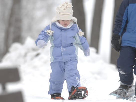 In this 2008 file photo, Maggie Wulf, of Wausau snowshoes
