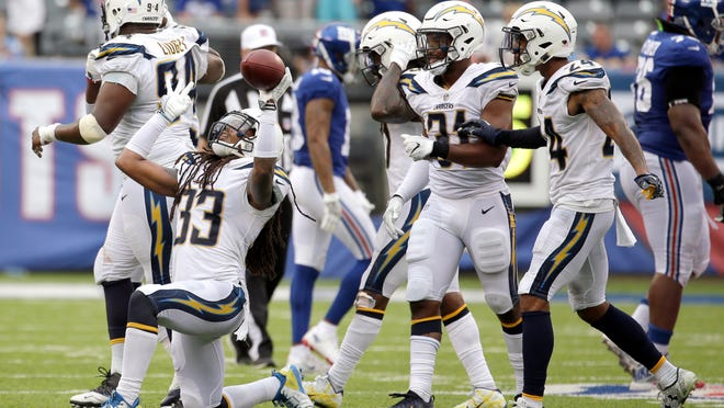 Los Angeles Chargers free safety Tre Boston (33) celebrates after intercepting a pass from New York Giants quarterback Eli Manning during the second half of an NFL football game, Sunday, Oct. 8, 2017, in East Rutherford, N.J. (AP Photo/Seth Wenig)