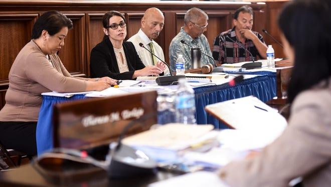 In this May 8 file photo, Department of Administration Director Christine Baleto, second from left, answers an inquiry from senators during a special legislative session at the Guam Congress Building in Hagåtña.
