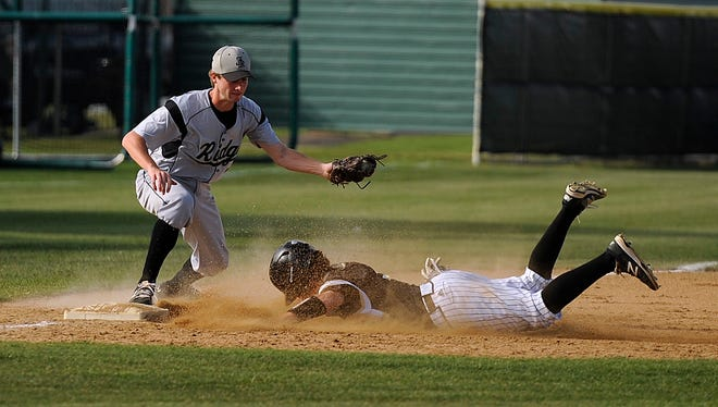 Abilene High's Andrew Ezzell (9) slides into third base ahead of the throw to Keller Fossil Ridge third baseman Justin Gordon (7) during the bottom of the fourth inning of the Eagles' 6-5 win on Tuesday, March 21, 2017, at AHS's Blackburn Field.