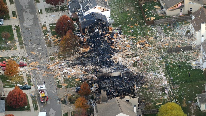 Aerial views of the two homes that were leveled and the numerous neighboring homes that were damaged from the explosion the night of Nov. 10, 2012, in the Richmond Hill subdivision, near Stop 11 and Sherman Drive.