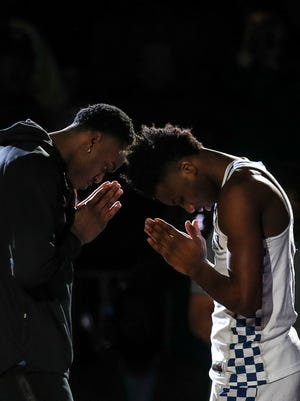 Kentucky's Jarred Vanderbilt, left, greets Hamidou Diallo during the introductions before the game against Kansas State Thursday, March 22, 2018 in Atlanta's Sweet Sixteen. UK would lose 61-58.