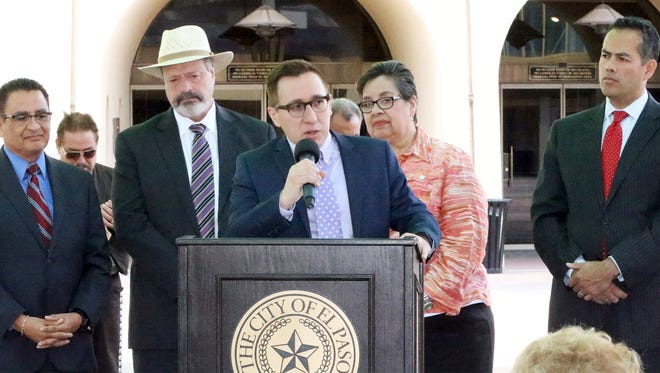 Ben Fyffe, center, assistant director of the El Paso Museums and Cultural Affairs Department, talks with other dignitaries and city officials about the planned Mexican American Cultural Center during a Cinco de Mayo news conference Thursday outside the Abraham Chavez Theatre in Downtown El Paso. Also attending were, from left, cultural center committee member Jaime Esparza, Mayor Oscar Leeser, city Rep. Lily Limón and City Manager Tommy Gonzalez.