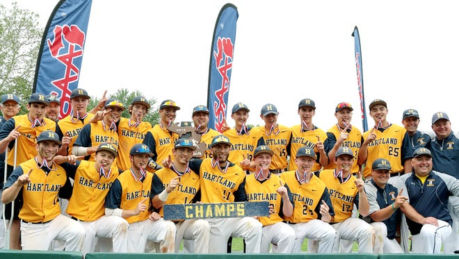 Hartland poses with the 2015 state Division 1 baseball championship trophy.