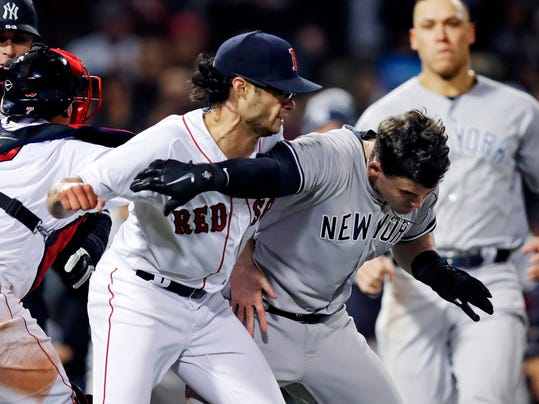 New York Yankees' Tyler Austin, right, scuffles with Boston Red Sox relief pitcher Joe Kelly, after being hit by a pitch during the seventh inning of a baseball game at Fenway Park in Boston, Wednesday, April 11, 2018. (AP Photo/Charles Krupa)