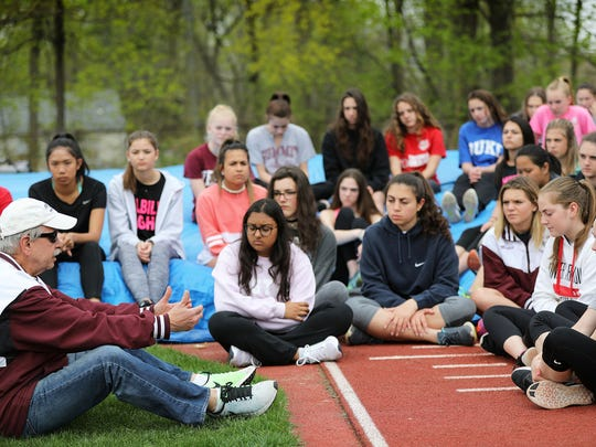 Verona High School Head Girl's Track and Field Coach, Gene Leporati, paused at the pole vault pit with his team as he talked about Tom Fleming.  Leporati said Fleming helped push for equal rights for female athletes.  Leporati of Wayne, told his athletes, it wasn't too long ago that NJ female athletes were not allowed to pole vault in high school competition.  Leporati knew Fleming for approximately 40 years. Thursday, April 20, 2017.
