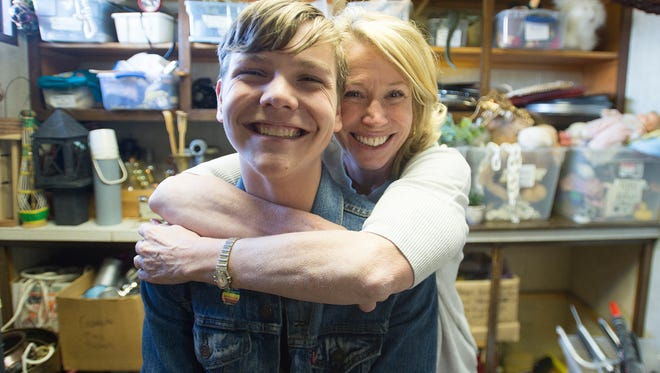 Peter Bachand gets a hug from Debut Theatre founder Lee Osterhout-Kaplan in the prop room on Wednesday, April 25, 2018. Bachand, 14, will be performing in the lead role of the Debut Theatre's latest production, Emil and the Detectives.