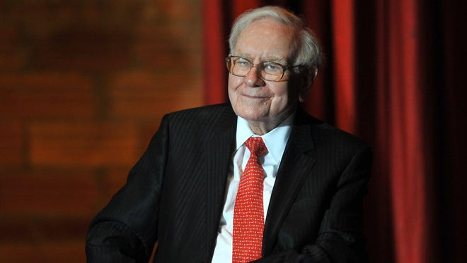 Billionaire Businessman Warren Buffett listens to a political rally at Sokol Auditorium on Dec. 16, 2015 in Omaha, Neb.