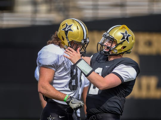 Quarterback Deuce Wallace, right, congratulates tight end Sam Hobbs on a play during the spring showcase practice at the Vanderbilt Stadium in Nashville, Tenn., Saturday, March 25, 2017.