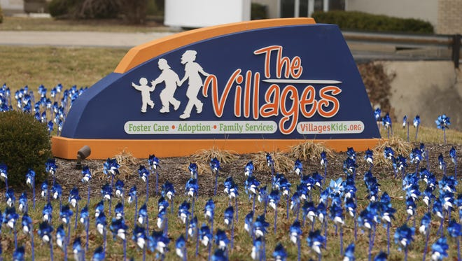 Volunteers and members of The Villages staff planted 1,000 pinwheels, each representing 85 children born in Indiana, to launch awareness for national Child Abuse Prevention Month, Friday, March 28, 2014.
