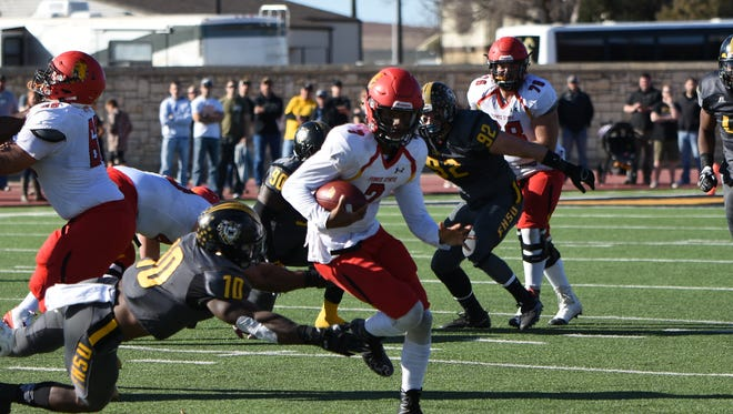 Ferris State quarterback Reggie Bell carries the ball against Fort Hays State Saturday.