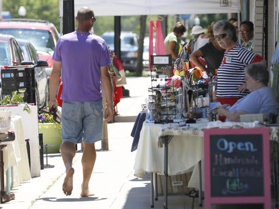 The Krazy Daze Sidewalk sales in downtown Manitowoc