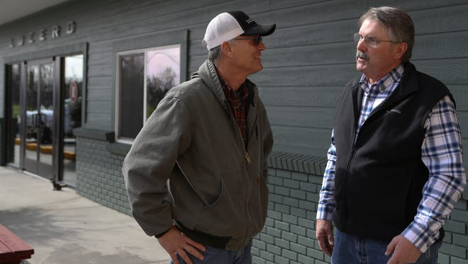 Tehama County Supervisor Bob Williams, right, talks to Larry Treat, master miller at Lucero Olive Oil, in Corning on in February. Williams introduced a successful resolution to declare that his county has never been a sanctuary for undocumented immigrants -- a potential first for California.