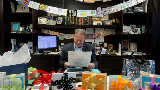 Belfor Holdings CEO Sheldon Yellen reads one of his birthday cards at his desk after being surprised by thousands of birthday cards for his 60th birthday on Wednesday, Jan. 17, 2018, in Birmingham, Mich. Yellen has sent more than 7,7000 hand written birthday cards to employees since 1985.