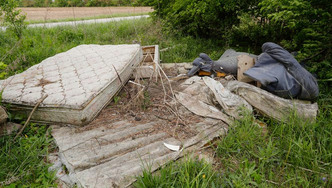 Mattresses piled in a heap off County Road E 150 S Monday, May 14, 2018,  just east of Lafayette.
