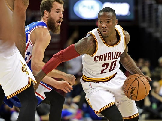 FILE - In this Saturday, Oct. 8, 2016 file photo, Cleveland Cavaliers guard Kay Felder (20) drives around Philadelphia 76ers guard Sergio Rodriguez (14) in the first half of an NBA preseason basketball game in Cleveland. Their roster overloaded, the Cavaliers are trading Richard Jefferson and Kay Felder to save money. Cleveland has agreed to send Jefferson, Felder, two second-round draft picks and $3 million to the Atlanta Hawks in a move that will allow the Eastern Conference champions to avoid paying $12 million in luxury tax penalties, a person familiar with the deal told The Associated Press on Friday, Oct. 13, 2017.  (AP Photo/David Dermer, File)