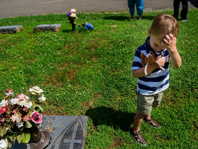 Four-year-old Tyler Hardin holds a toy that once belonged