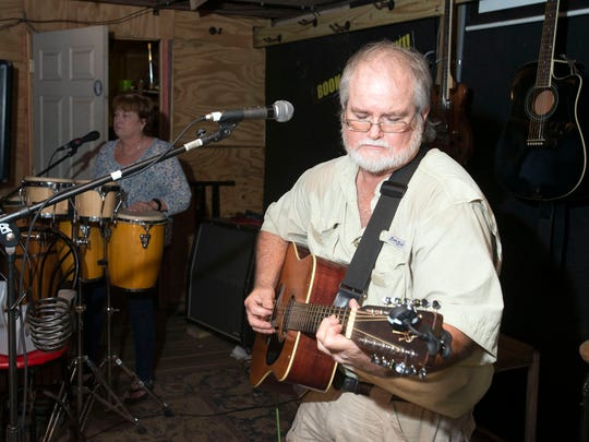 Mike Boccia, right, and Wanda Nichols, left, provide some musical entertainment from the crowd gathered at the Goat Lips Chew and Brewhouse. Goat Lips is a popular hangout and watering hole from many in the area around the Copter Road establishment including University of West Florida students and employees.