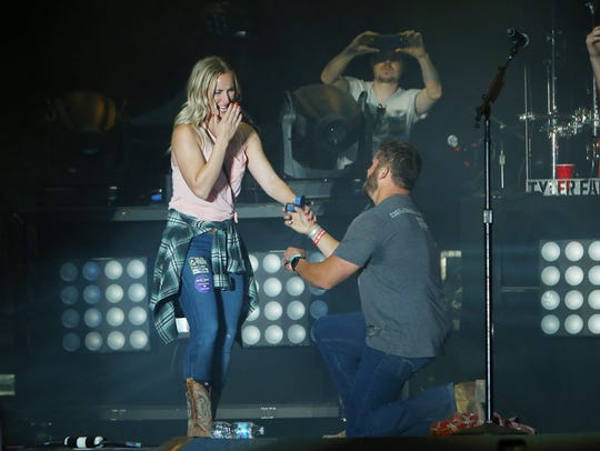Country music artist Tyler Farr invites a couple on