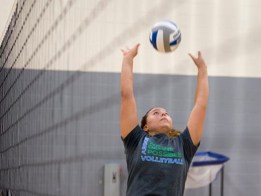 Senior Monique StCyr, center, during volleyball practice at the University of West Florida on Monday, August 28, 2017.