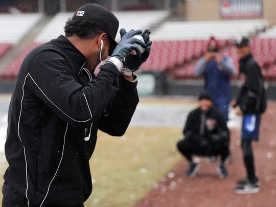Timber Rattlers players substitute snowballs for baseballs during the team's media day Tuesday at Fox Cities Stadium.