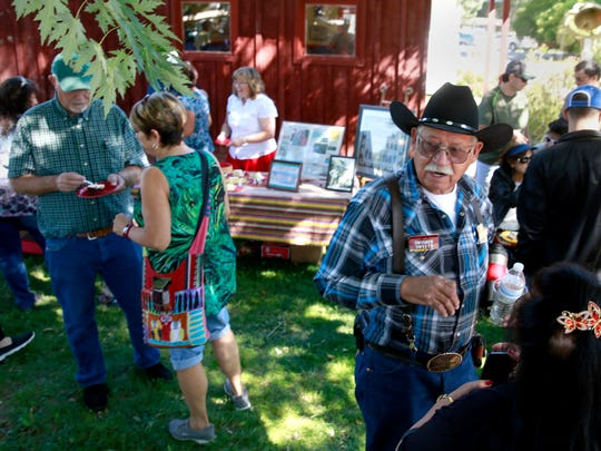 Leonard Trujillo talks with a friend during Founders Day on Saturday at the Aztec Museum & Pioneer Village.
