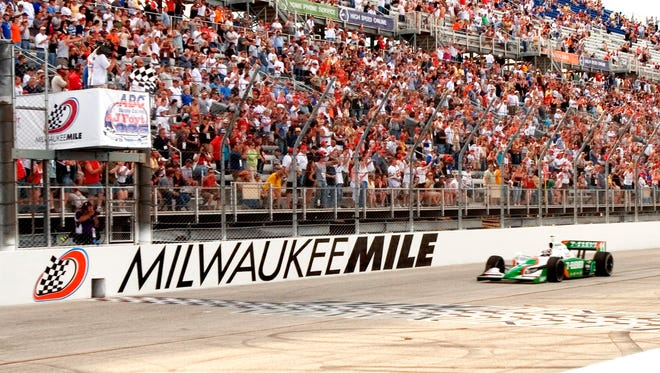 Tony Kanaan takes the checkered flag as he wins the ABC Supply/A.J. Foyt 225 race presented by Time Warner Cable at the Milwaukee Mile on June 3, 2007.