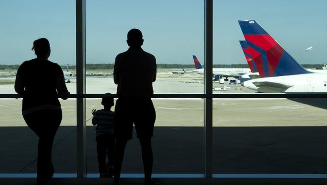 FILE photo: Brandy Elam, her son Brayden, 3, and her father Joe Elam of Bonita Springs wait for the arrival of Brayden's grandmother from Canada at Southwest Florida International Airport in south Fort Myers.