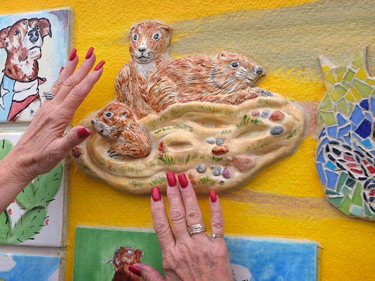 An example of the three distinct formes used to make up the Arts for All Community Mural. Painted ceramic tiles, mosaic tiles and sculpted three-dimensional clay are arranged on the 30x18-foot mural.