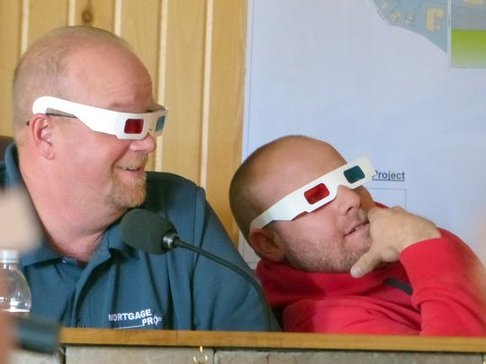 Mark Flack and Jon Tondino, Ruidoso Planning Commissioner, watch a short three-dimensional ad for the Piney pods.