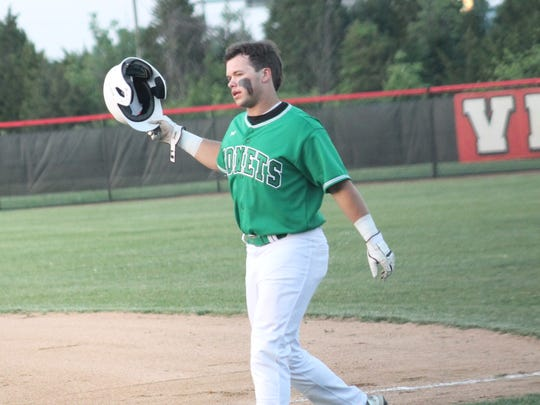 Mason slugger JP Sponseller heads to the field after