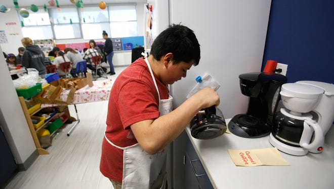 Alex Martinez pours coffee on Feb. 5 at Hermosa Middle School's Fantastic 7 Café in Farmington.