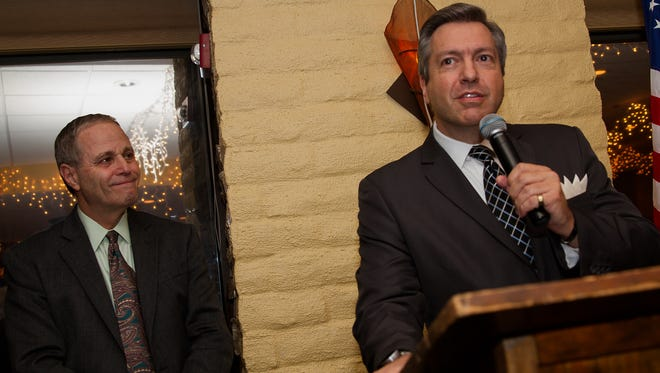 Scott Michlin speaks after accepting the citizen of the year award from presenter Ron Price, left, during Friday's Farmington Chamber of Commerce banquet at the San Juan Country Club.