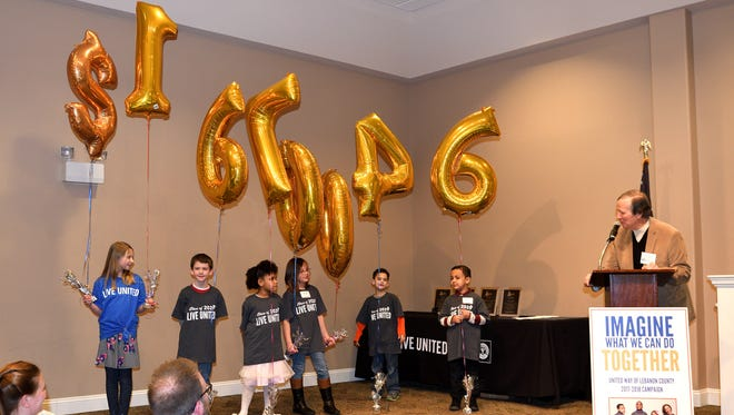 The United Way 2017-18 campaign total of $1,670,046 revealed  via balloons by Bob Hoffman (at podium) with the help of Lebanon County elementary school students.