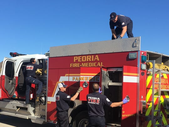Four firefighters from the Peoria Fire-Medical Department