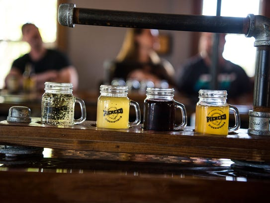 A flight of ciders at Pierced Ciderworks sits on the