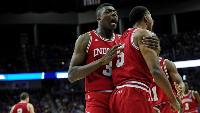 Indiana Hoosiers center Thomas Bryant (31) celebrates with Indiana Hoosiers forward Troy Williams (5) after a play in the second half against the Kentucky Wildcats during the second round of the 2016 NCAA Tournament at Wells Fargo Arena.