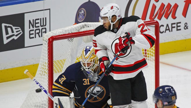 Buffalo Sabres goalie Anders Nilsson (31) makes a save against New Jersey Devils right wing Devante Smith-Pelly (25) during the third period of an NHL hockey game, Friday, Nov. 11, 2016, in Buffalo, N.Y. (AP Photo/Jeffrey T. Barnes)