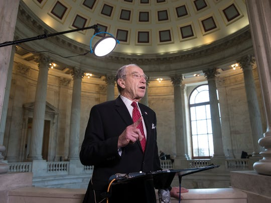 Senate Judiciary Committee Chairman Chuck Grassley (R-Ia.) discusses President Donald Trump's new trade tariffs during a television news interview in Washington on Monday.