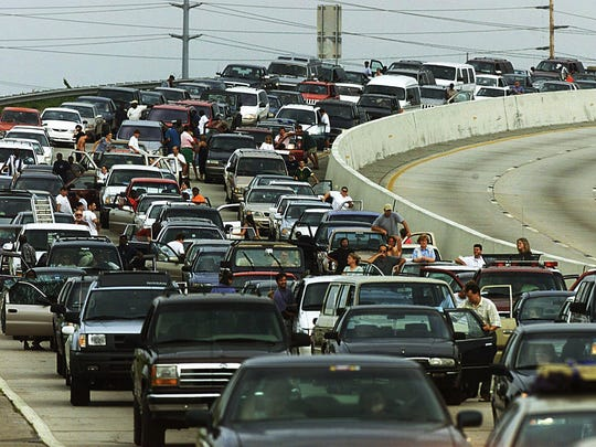 Thousands of residents forced out by a mandatory evacuation order sit on Interstate 26 near Charleston, S.C. Tuesday afternoon, Sept. 14, 1999 as they try to move west away from the path of approaching Hurricane Floyd. (AP Photo/Charlotte Observer, Patrick Schneider)